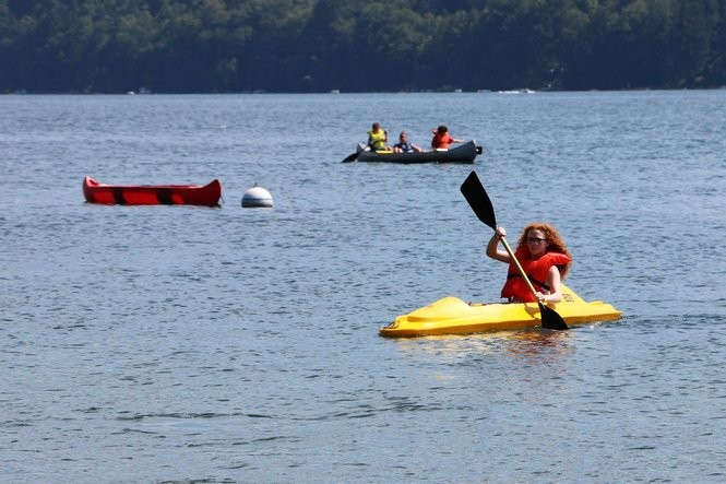 Campers kayak on Skaneateles Lake at Lourdes Camp in August 2017. (Katrina Tulloch photo)