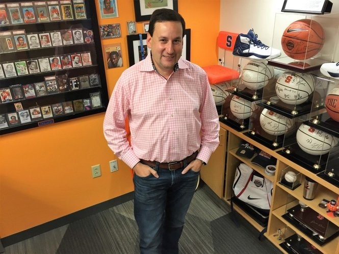 Jeffrey Rubin, founder, president and CEO of Sidearm Sports, stands in his office full of Syracuse University sports memorabilia. (Rick Moriarty | rmoriarty@syracuse.com)