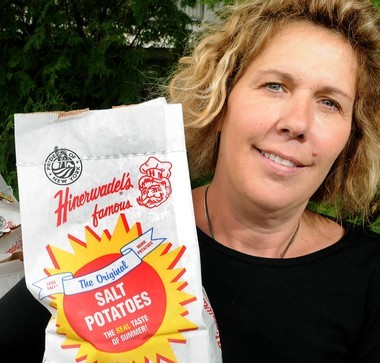 Vicky Hinerwadel holds a bag of Hinerwadel's Grove's signature product, salt potatoes, in this 2009 photo.