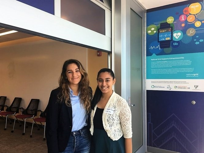 Syracuse University College of Engineering and Computer Science students Kayla Simon, left, and Elizabeth Tarangelo (both class of 2019), co-founders of In-Spire, are among the winners of Upstate Medical University's 2018 Medical Device Innovation Challenge for their invention of a wearable medicine dispenser. They are pictured at the Central New York Biotech Accelerator's Concept to Commercialization Boot Camp in September 2018.