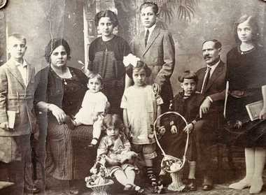 Caterina Ascioti, second from left, and Antonio Ascioti, second from right, with eight of their children in an undated photo. The two youngest children hadn't been born yet, so the photo is likely from the mid-1920s.