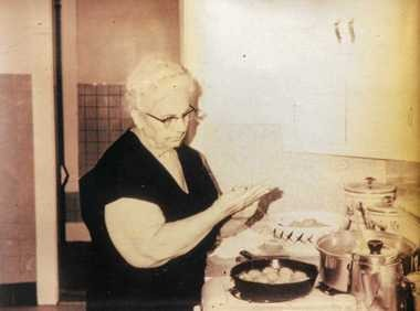 Caterina (Catherine) Ascioti working at Ascioti's Market, in this undated photo that hangs behind the meat counter.