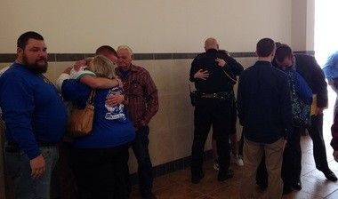 """Christopher """"Mike"""" Buss (far left) and family and friends console one another after sentencing today."""
