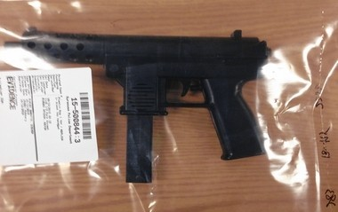 An air gun, styled to look like an Uzi sub-machine gun, used by four Syracuse teenagers to rob a pizza delivery man.