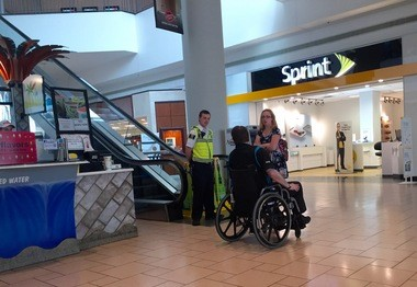 A Destiny USA security guard blocks the escalators to the third floor as Syracuse police investigate.