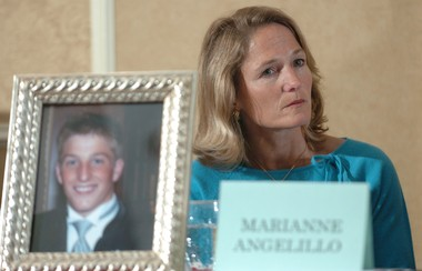 Marianne Angelillo, of Skaneateles, listens to speakers at a community forum on underage drinking held at the Holiday Inn in Auburn, in this 2005 file photo. At left is a picture of her son Matt who was killed last June in a DWI car accident.