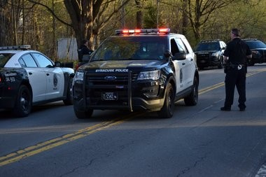 Police on Route 11A on the Onondaga Nation Saturday following a chase with a van that began in the city of Syracuse.