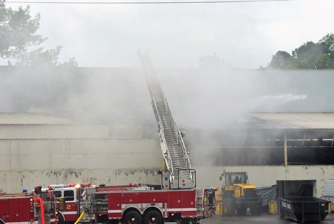 Recyclables caught fire inside Syracuse Haulers in DeWitt, sparking a fire that spread inside the Thompson Road building on Wednesday, June 13, 2018. Samantha House