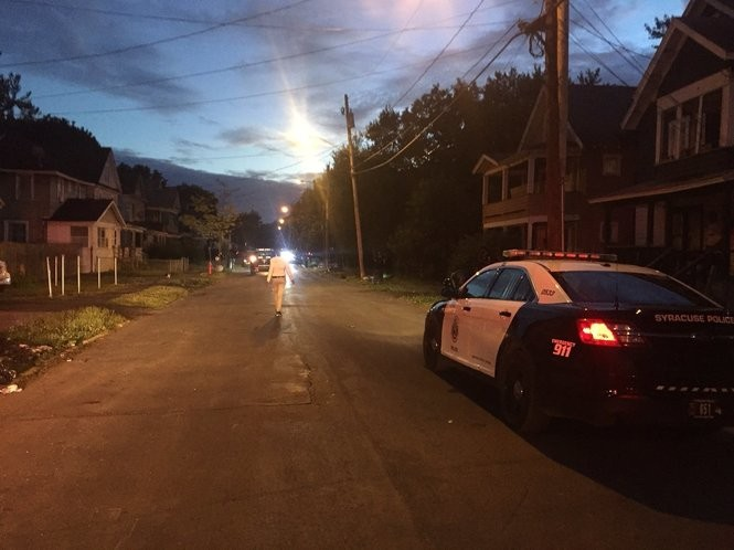 A man walks down Fernwood Avenue on Tuesday as police leave the scene of a large fight.