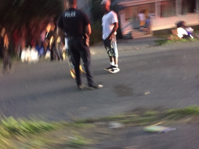 A man is questioned by police following a fight and reports of gunshots on Tuesday evening.