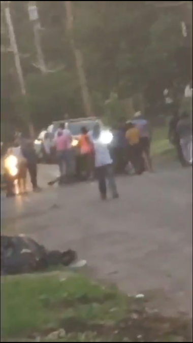 A screenshot of this blurry video provided to Syracuse.com shows a small crowd of people scuffling in the middle of Fernwood Avenue as police try to break them up.