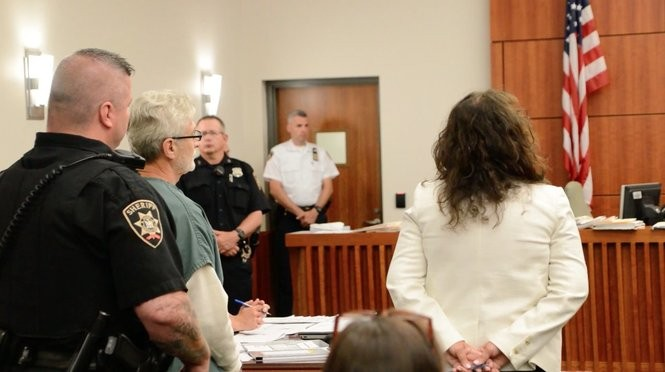 Robert Neulander stands next to his lawyer, Kim Zimmer, during a bail hearing July 9, 2018.