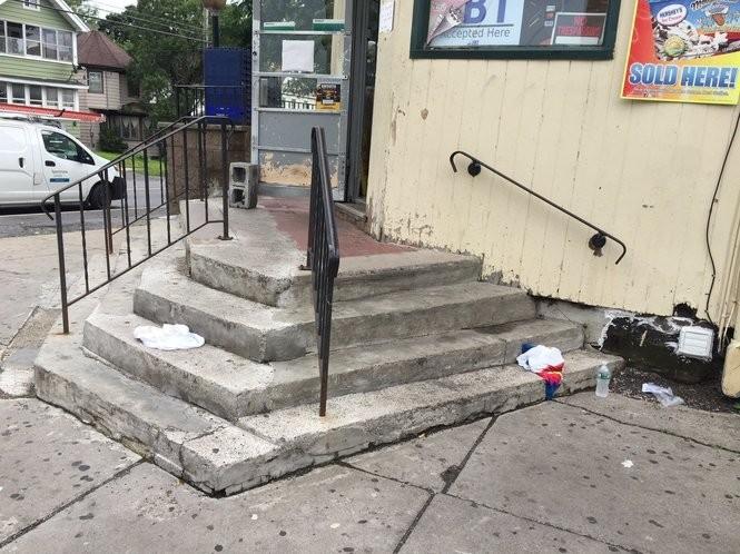 The victim's tank top and tie dye shirt were left on the steps of the Teall Market (Chris Libonati | clibonati@syracuse.com).