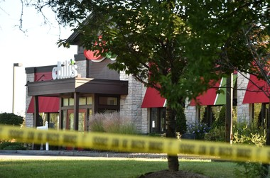 Police tape blocks off the Chili's in DeWitt after a deadly robbery on Saturday, Sept. 15, 2018.