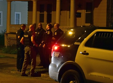 Syracuse police search for evidence after a reported assault Thursday night at 323 Coolidge Ave. Photo by Scott Schild   sschild@syracuse.com