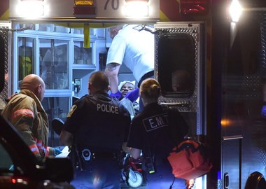 American Medical Response (AMR) ambulance transport a man from 323 Coolidge Ave. after a reported assault shortly after 9 p.m. Thursday. Police and EMTs were called to Coolidge Avenue shortly after a vigil Thursday night for a teen killed nearby Wednesday night. Photo by Scott Schild   sschild@syracuse.com