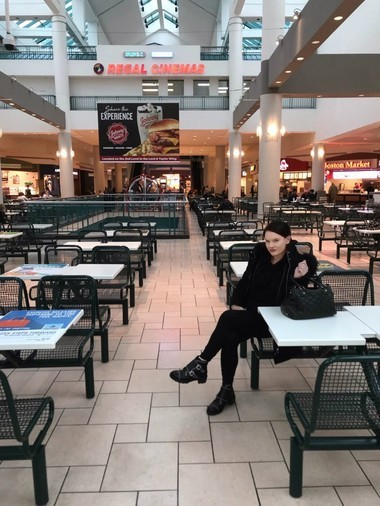 Emily Moore, 30, of Fayetteville, sits in the food court at Destiny USA in Syracuse near where she administered Narcan and saved a man's life. ACR Health provides free training and access to Narcan to everyone.