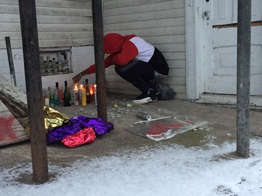 Anthony Tate, a good friend of Gullotto's, lights candles for his friend on Tuesday.
