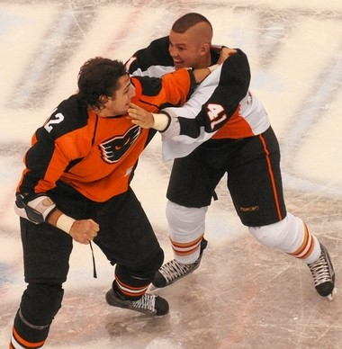 Jon Mirasty of the Syracuse Crunch, right, fights with Garrett Klotz of the Adirondack Phantoms in a 2010 game in the War Memorial.