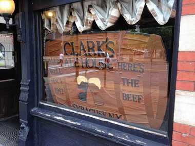 A sign in the building at Washington and Salina streets alerts passersby that Clark's Ale House is on its way.