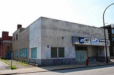 The exterior of 301 Franklin St. in Buffalo, before renovations began to turn it into the eighth Dinosaur Bar-B-Que restaurant. The marble Universal-International logo was discovered under this exterior.