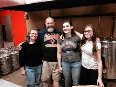 Double Barrel Brewing Co. owner Pete Kirkgasser with his family: wife Janet, and daughters Christina and Katie.
