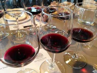 Glasses of Saperavi during a tasting at Standing Stone Vineyards on Seneca Lake show ithe wine's distinctive deep, inky red color..