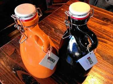 Two stoneware growlers made by Orange Vessel Co. of Syracuse. The company is owned by Steve Tarolli and Rob Englert. (See video review below).