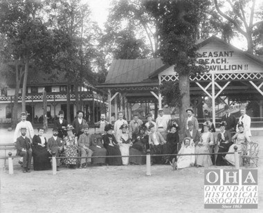 Visitors pose for a picture in front of the pavillion at Pleasant Beach on the western shore of Onondaga Lake.