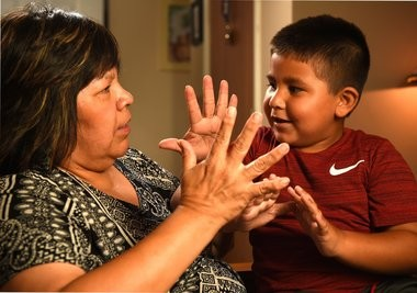 Caroline Touse and her grandson Dredin Thomas, 6, count to 10 in the Onondaga language. Caroline has been learning the language from Dredin who learns Onondaga at the Onondaga Nation School.