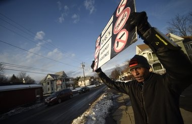 "Clifford Ryan, holds his sign that says ""O.G's against gun violence."" on the corner of Midland and Colvin in Syracuse. Ryan fed up with the violence after a particularly violent Fourth of July weekend in 2015, decide to hit the streets. Ryan himself has had violence touch his family with the shooting death of his son in 1999. Dennis Nett 