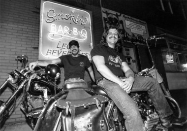 "Mike Rotella, left, sitting on a 1989 Harley Davidson, and John Stage, on his 1957 classic ""hog,"" at the Dinosaur in 1992."