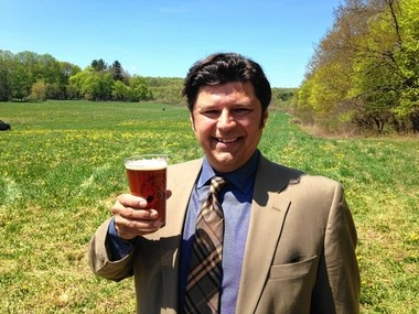 David Katleski, owner of Empire Brewing Co. in Syracuse, toasts the groundbreaking of the Empire Farmstead Brewery in Cazenovia in May 2015.