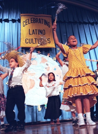 In this 1999 file photo, students at the Delaware school celebrate Latino heritage month.