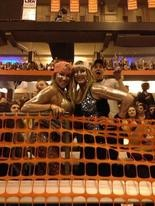 Two glitter-covered Ke$ha fans at the Dome