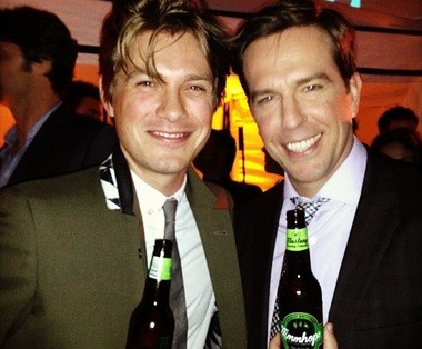 """Taylor Hanson shares Hanson's new beer called """"MmmHops"""" with actor Ed Helms at """"The Hangover Part III"""" premiere."""