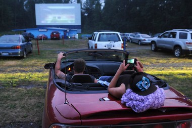 Moviegoers relax before the start of a movie at the Finger Lakes Drive-In in 2010.