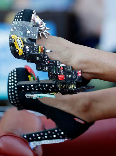 Miss New York Nina Davuluri displays her shoes during the Miss America Shoe Parade at the Atlantic City boardwalk, Saturday, Sept. 14, 2013, in Atlantic City, N.J.