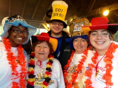 Family members (from left) Shontella Ellick, Brigitte Niebuhr, Jonathan Fitzgibbon, Susan Niebuhr and Jessica Fitzgibbon work the hot food tent at the 2013 Great Syracuse Oktoberfest.