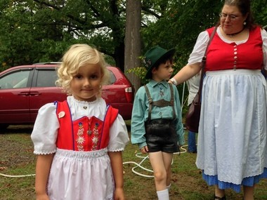 Chloe Raith, 4, and Walter Hauer, 5, dress in traditional German costumes at the 2013 Great Syracuse Oktoberfest on Sunday, October 6. Raith is the granddaughter of Klaus Raith, the CNY German-American Society's vice president.