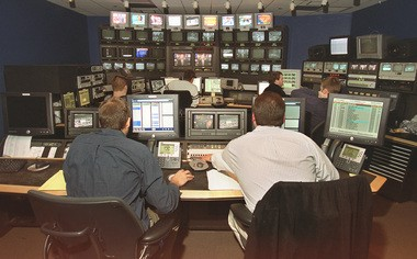 Time Warner's News 10 Now prepares to launch the new 24-hour local news channel in November. L-R; in foreground are assistant producer Nate Holst and producer Joe Piraneo work in the control room in the former New York Central Station on Erie Boulevard East.