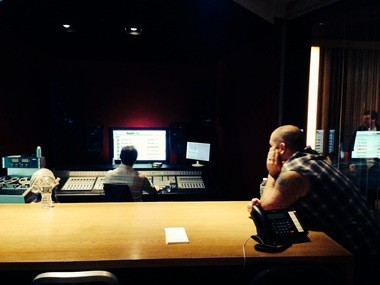 Joe Altier, right, and Amanda Rogers listen to the finished product in the control room at Subcat Studios