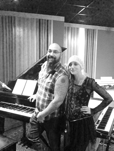 Joe Altier, left, and Amanda Rogers pose in Studio A of Subcat Studios following their recording session for the Subcat Sessions.