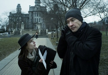 "This production still released by Treehouse Pictures shows John Cusack and Emma Roberts on the Syracuse University campus in a scene from ""Adult World."""