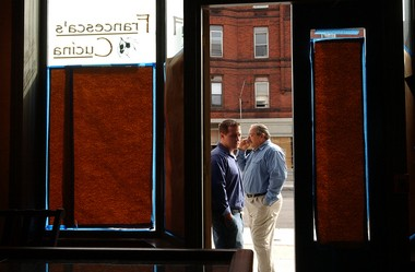George A. Angeloro, left, and his father, George D. Angeloro, right, put finishing touches on Francesca's Cucina, 541 North Salina St., Syracuse.