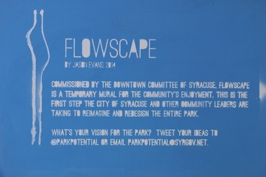 "Jason Evans designed ""Flowscape"" with blue and white paint, because traffic paint only comes in three colors: yellow and white for road markers and blue for handicapped spaces."