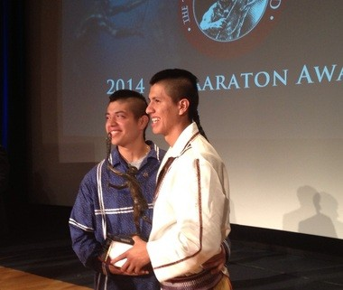 Miles and Lyle Thompson pose with the Tewaaraton Award, college lacrosse's most prestigious honor. The brothers are from the Onondaga Nation and will be honored at the Stage of Nations Blue Rain ECOfest.