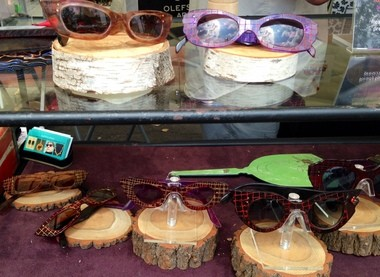 Custom art eyeglasses made by Laurie Olefson at the Syracuse Arts and Crafts Festival Sunday.