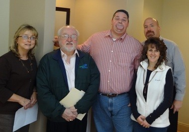 The Guinness World Records required two notaries and doctor to confirm the width of Byron Schlenker's record-breaking tongue. From left to right, notary Kathy Huckabone, notary Robert Schuyler, record holder Byron Schlenker, Charlene Rivera and Dr. Joseph Colosi pose together.