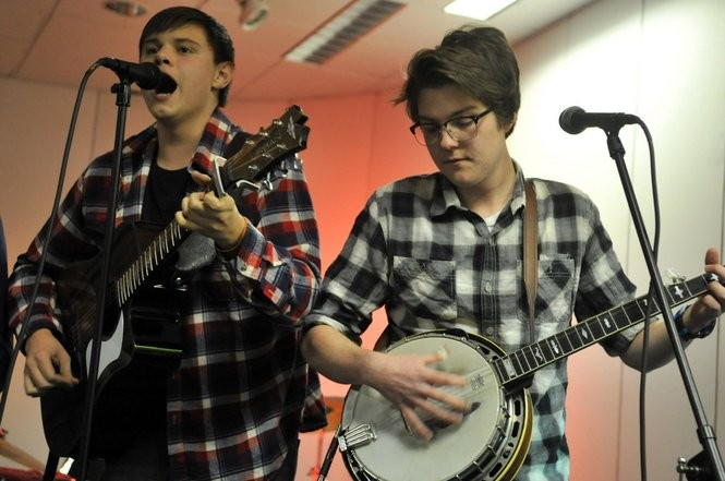 Aaron Fern, left, and Sean King of Casual Plaid perform during The Jewish Community Center of Syracuse's 13th annual Battle of the Bands on Saturday, Jan. 17, 2015. Casual Plaid took first place in the battle. Photo by Scott Schild.